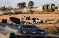 Members of the Tripoli Rebels Brigade militia patrol a main road in Tajura, 15 kms from the capital Tripoli, on November 16, 2013, after foiling attempts by Misrata-based militiamen to advance into the city earlier in the day
