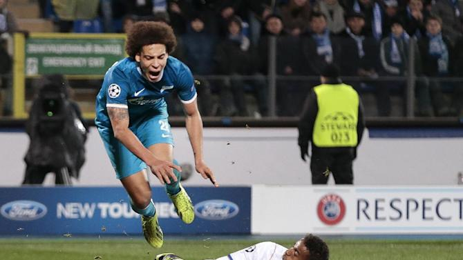 Zenit's Axel Witsel, top, is challenged by Porto's Danilo during the Champions League group G soccer match between Zenit and Porto at Petrovsky stadium in St.Petersburg, Russia, on Wednesday, Nov. 6, 2013