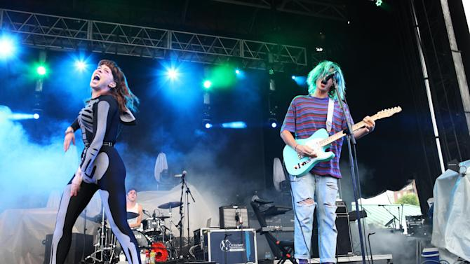 "FILE - This May 18, 2013 file photo shows Hannah Hooper, left, and Christian Zucconi of Grouplove performing as part of Party in the Park at Centennial Olympic Park in Atlanta. Grouplove's, ""Ways to Go,"" was the most viral track on Spotify, from Monday, June 10, to Sunday, June 16, via Facebook, Tumblr, Twitter and Spotify.  (Photo by Robb D. Cohen/RobbsPhotos/Invision/AP, file)"