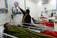 Patients who consumed toxic cough syrup receive treatment in a hospital in Gujranwala on Saturday. At least 24 people, mostly drug addicts seeking a fix, have died after drinking toxic cough syrup in an eastern Pakistani city, officials said on Saturday