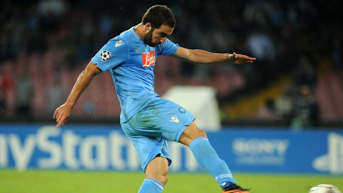 Napoli's Gonzalo Higuain scores during a Champions League, group F, soccer match between Napoli and Marseille, at the Naples San Paolo stadium, Italy, Wednesday, Nov. 6, 2013