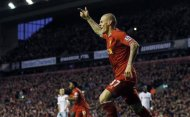 Liverpool's Martin Skrtel celebrates after his team scored during their English Premier League soccer match against West Ham United at Anfield in Liverpool, northern England December 7, 2013. REUTERS/Phil Noble