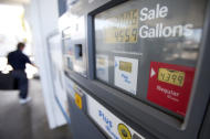 In this Feb. 21, 2012 photo, a man passes a gas pump showing the price of regular gasoline at a gas station, in San Diego. A sharp jump in gas prices drove a measure of US consumer costs up in February. But outside higher pump prices, inflation stayed mild. (AP Photo/Gregory Bull)