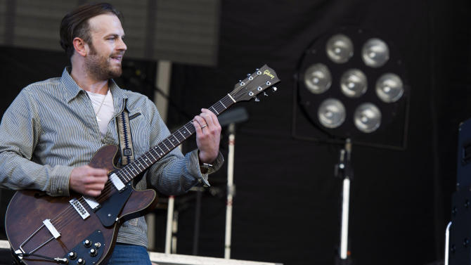 FILE - In this June 8, 2013 photo, Caleb Followill from the band Kings of Leon performs at the 3rd annual Governors Ball Music Festival in New York. The Followills are reaching out to help Oklahoma after a series of tornadoes killed dozens of people last spring with a benefit concert in Oklahoma City featuring The Flaming Lips, Jackson Browne and Built to Spill. (Photo by Charles Sykes/Invision/AP, File)