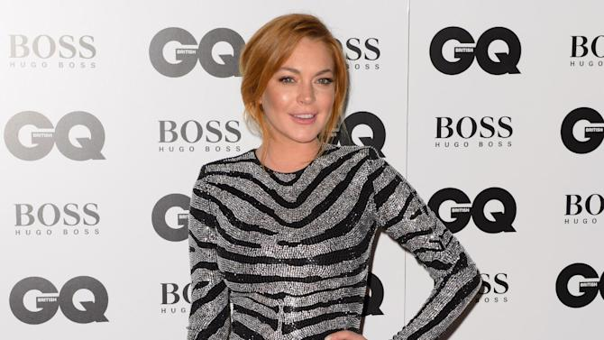 "FILE- In this Sept. 2, 2012 file photo, Lindsay Lohan arrives for the GQ Men Of The Year Awards 2014 at a central London venue, London. A Los Angeles judge on Wednesday Feb. 25, 2015, ordered Lohan to re-do 125 hours of community service after a prosecutor determined the actress was given credit for time she spent performing in a London production of ""Speed-the-Plow."" (Photo by Jonathan Short/Invision/AP, File)"