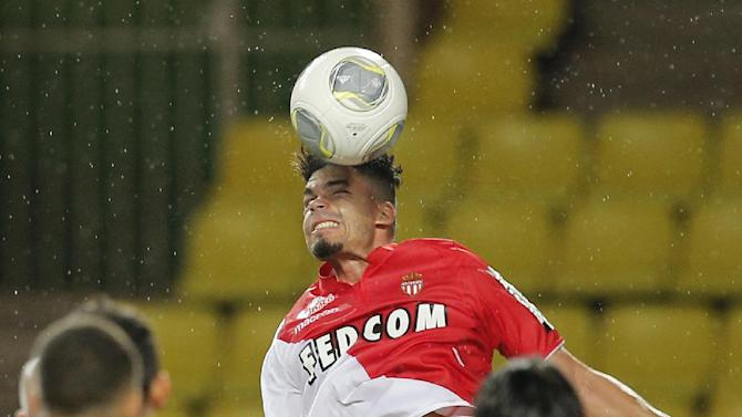 Monaco's Emmanuel Riviere of France jumps for the ball during the French League One soccer match against Bastia, in Monaco stadium, Wednesday, Sept, 25, 2013