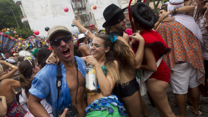"People dance during the ""Ceu na Terra"" block carnival parade in Rio de Janeiro, Brazil, Saturday, Feb. 9, 2013. According to Rio's tourism office, Rio's street Carnival this year will consist of 492 block parties, attended by an estimated five million Carnival enthusiasts. (AP Photo/Silvia Izquierdo)"