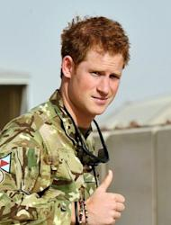 "Prince Harry gives the thumbs up upon his arrival at Camp Bastion in Afghanistan on September 7. ""We will do our best to kill Prince Harry and Britain's other troops based in Helmand,"" a militia spokesman told AFP."