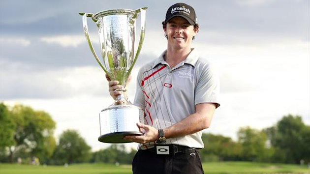 Rory McIlroy of Northern Ireland poses with the champion's trophy after winning the PGA Championship golf tournament in Carmel, Indiana (Reuters)