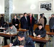 """This photo, taken by North Korea's official Korean Central News Agency on January 9, 2013, shows former New Mexico Governor Bill Richardson (centre, L) and Google executive chairman Eric Schmidt (centre, R) visiting the Grand People's Study House in Pyongyang. Richardson and Schmidt were in North Korea for a """"private trip."""""""