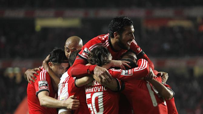 Benfica's players celebrate after Nico Gaitan, from Argentina, scored the opening goal of the game against Sporting during the Portuguese league soccer match between Benfica and Sporting at Benfica's Luz stadium, in Lisbon, Tuesday, Feb. 11, 2014