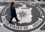 A man crosses the Central Intelligence Agency (CIA) logo in the lobby of CIA Headquarters in Langley, Virginia. The man ordered by Al-Qaeda's branch in Yemen to blow up a US-bound airliner was a double agent who infiltrated the group and volunteered for the suicide attack, US media reported Tuesday