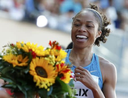 Felix of the U.S. celebrates victory in the 200 metres women event at the IAAF Diamond League Athletissima athletics meeting at the Pontaise Stadium in Lausanne
