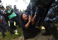 Nepal police detain Tibetans who were shouting anti-China slogans in tribute to the Tibetans who died in the recent self-immolation, in Katmandu, Nepal, Tuesday, Nov. 1, 2011. Nepal police detained more than 100 Tibetans exiles who were protesting against Chinese rule over their homeland. (AP Photo/Niranjan Shrestha)