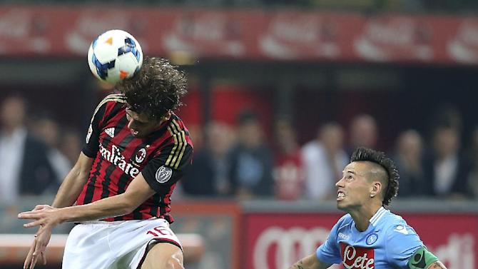 AC Milan midfielder Andrea Poli, left, jumps to head the ball as Napoli midfielder Marek Hamsik, of Slovakia, looks at him during the Serie A soccer match between AC Milan and Napoli at the San Siro stadium in Milan, Italy, Sunday, Sept. 22, 2013