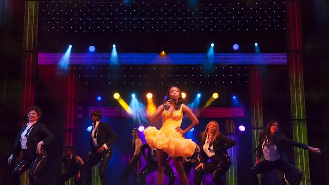 In this undated image made available Thursday Dec. 6, 2012, by the Adelphi Theatre, showing Heather Headley performing in the lead role as Rachel Marron in the new musical stage show The Bodyguard, directed by Thea Sharrock, not pictured, which is due to open at the Adelphi Theatre in London in December 5, 2012.  The stage show is based on the 1992 Bodyguard movie starring Whitney Houston in the lead role. (AP Photo / Paul Coltas, Adelphi Theatre)