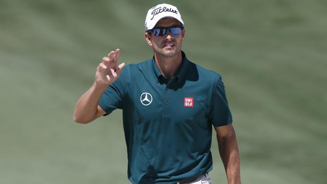 Golf - Scott overtakes Woods as world number one