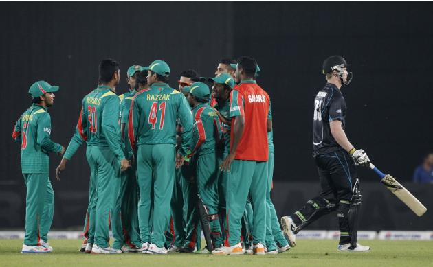 New Zealand's Neesham leaves the field as Bangladesh's fielders celebrates his dismissal and a hattrick by Hossain during their first one-day international cricket match in Dhaka.