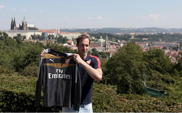 Cech shows his Arsenal jersey during his presentation in Prague