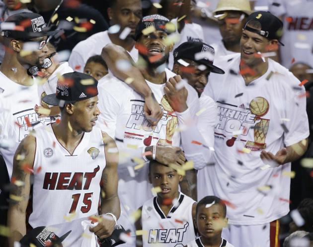 FILE - In this June 21, 2013 file photo, Miami Heat players including LeBron James, top center, celebrate after Game 7 of the NBA basketball championship game against the San Antonio Spurs, in Miami.