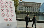 Chinese security officers patrol in a park beside the Great Hall of the People in Beijing on November 12, 2012. A senior Chinese official has lost his job, state media said on Thursday, after a jilted mistress detailed their alleged affair in an online essay topping 100,000 written characters