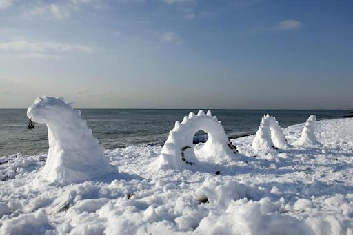 A snow sculpture of the Loch Ness Monster pictured on Brighton Beach, southern England, on December 18, 2009