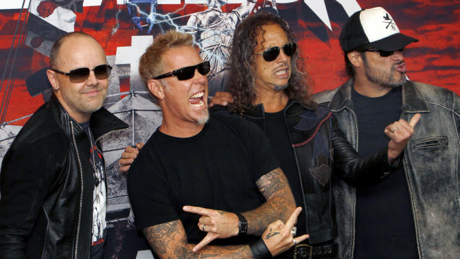 """FILE - In this Saturday, July 28, 2012 file photo, members of the band Metallica, from left to right; Lars Ulrich, James Hetfield, Kirk Hammett and Robert Trujillo, pose before their first of eight concert performances in Mexico City. Metallica is set to rock the legendary Apollo Theater in Harlem venue on Sept. 21. It will promote their 3D concert-action film """"Metallica Through the Never,"""" released in IMAX on Sept. 27 and other theaters a week later. It will also air live on a special temporary Metallica channel on SiriusXM. (AP Photo/Marco Ugarte, File)"""