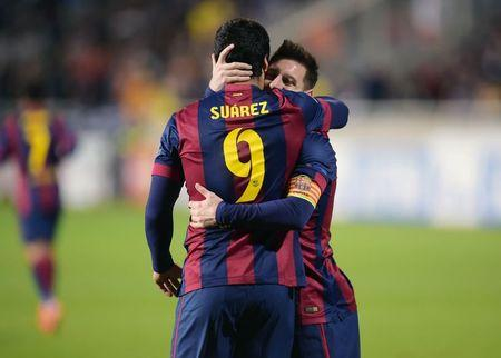 Barcelona's Suarez celebrates his goal against APOEL Nicosia with Messi during their Champions League soccer match in Nicosia