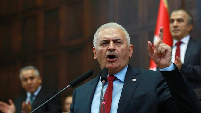 Turkish Prime Minister and leader of the ruling Justice and Development Party (AK Party), Binali Yildirim, speaks in Ankara on July 19, 2016