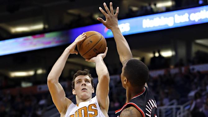 Phoenix Suns' Goran Dragic (1), of Slovenia, shoots over Portland Trail Blazers' Damian Lillard during the second half of an NBA basketball game, Wednesday, Nov. 27, 2013, in Phoenix