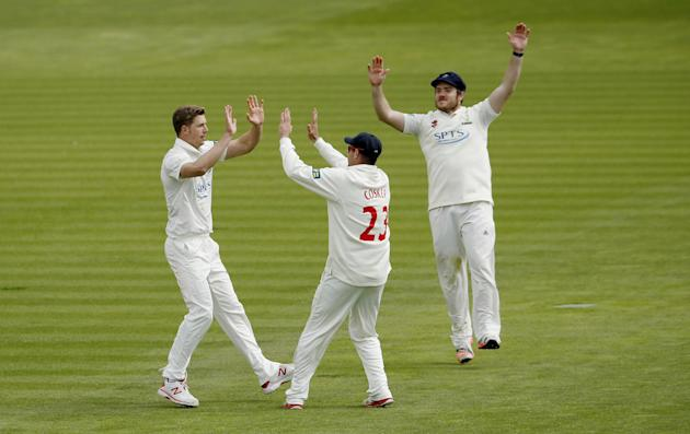 Cricket: Glamorgan's Craig Meschede celebrates taking the wicket of Surrey's Kevin Pietersen (not pictured) with Dean Cosker