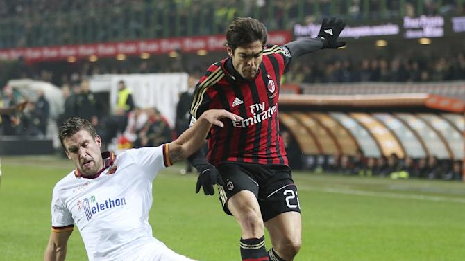 AC Milan Brazilian forward Kaka, right, is tackled by AS Roma midfielder Kevin Strootman, of the Netherlands, during the Serie A soccer match between AC Milan and Roma at the San Siro stadium in Milan, Italy, Monday, Dec. 16, 2013