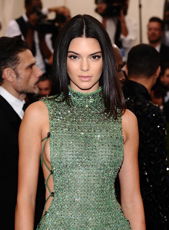 "Kendall Jenner arrives at The Metropolitan Museum of Art's Costume Institute benefit gala celebrating ""China: Through the Looking Glass"" on Monday, May 4, 2015, in New York. (Photo by Charles Sykes/Invision/AP)"