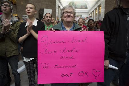 Mary Beth Keidl holds a sign during a rally supporting same-sex marriage at the state capitol in Salt Lake City, Utah January 10, 2014. REUTERS/Sallie Dean Shatz