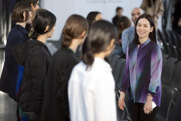 French designer Christine Phung speaks to models before her Autumn/Winter 2015/2016 women's ready-to-wear collection show during Paris Fashion Week