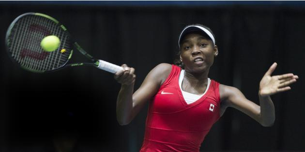 Canada's Francoise Abanda returns the ball to Romania's Irina-Camelia Begu during their Federal Cup tennis match in Montreal, Saturday, April 18, 2015. (Graham Hughes/The Canadian Press via AP