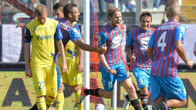 Catania's Jaroslav Plasil, of Czech Republic, center, celebrates after scoring during the Serie A soccer match between Catania and Chievo Verona at the Angelo Massimino stadium in Catania, Italy, Sunday, Sept. 29, 2013