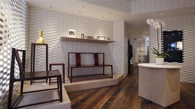 Furniture are displayed for sale in the shop of the young brand Shang Xia on its opening day in Paris