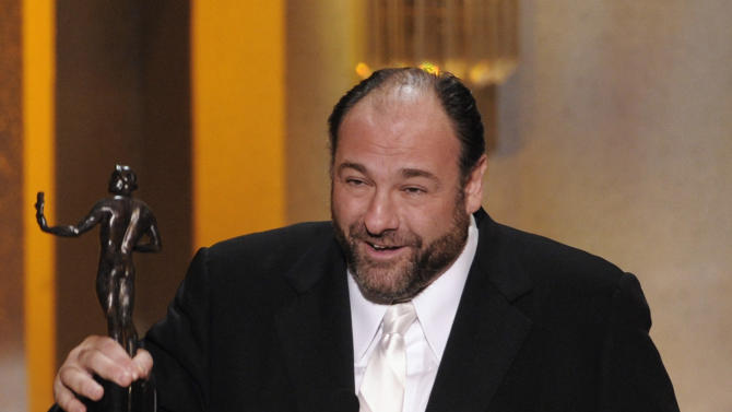 """FILE - This Jan. 27, 2008 file photo shows actor James Gandolfini accepting the award for outstanding performance by a male actor in a drama series for his work in """"The Sopranos"""" at the 14th Annual Screen Actors Guild Awards in Los Angeles. HBO and the managers for Gandolfini say the actor died Wednesday, June 19, 2013, in Italy. He was 51. (AP Photo/Mark J. Terrill, file)"""
