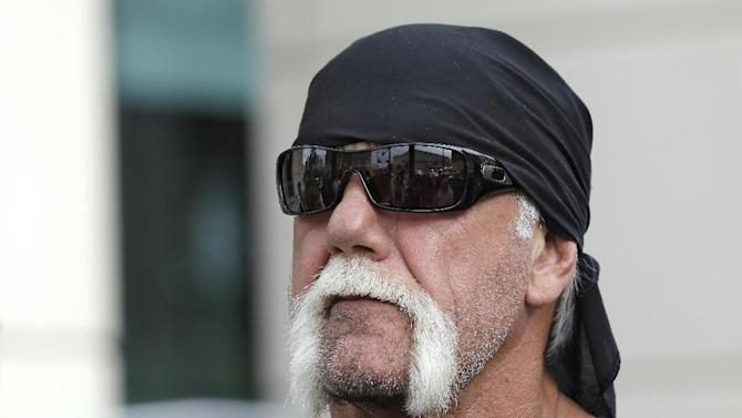 FILE - In this Oct. 15, 2012 file photo, reality TV star and former pro wrestler Hulk Hogan, whose real name is Terry Bollea, listens during a news conference at the United States Courthouse in Tampa, Fla. The Tampa Bay Times reported Monday, Jan. 14, 2013 that Hogan has filed a lawsuit against the Tampa-based Laser Spine Institute, saying the clinic did unnecessary surgeries that damaged his career. (AP Photo/Chris O'Meara, File)