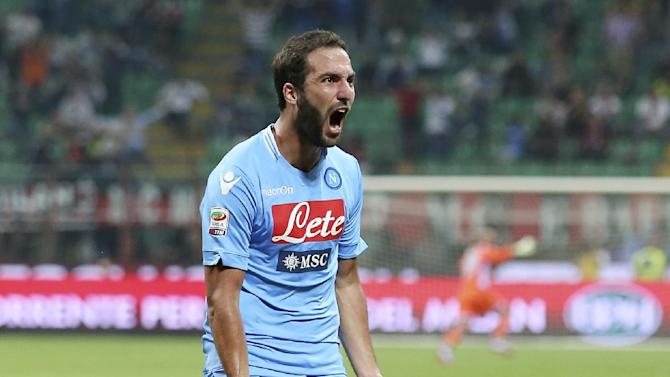 Napoli forward Gonzalo Higuain, of Argentina, celebrates after scoring during the Serie A soccer match between AC Milan and Napoli at the San Siro stadium in Milan, Italy, Sunday, Sept. 22, 2013