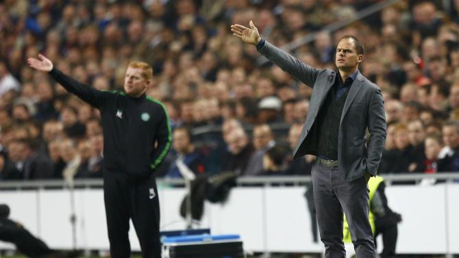 Celtic's coach Lennon and Ajax Amsterdam's coach De Boer react during their Champions League soccer match at Amsterdam Arena