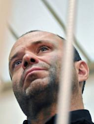 Dmitry Pavlyuchenkov in a court room in Moscow on August 26, 2011. The former police officer has been charged with murder for being part of a criminal group that gunned down Politkovskaya in 2006. Investigators believe the gang was formed on the orders of Chechen criminal boss Lom-Ali Gaitukayev.