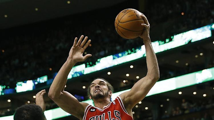 In this March 30, 2014 file photo, Chicago Bulls' Joakim Noah (13) goes to the basket as Boston Celtics' Jeff Green, left, defends in the first quarter of an NBA basketball game in Boston. Chicago wound up with 48 wins in a season that could have gone all wrong