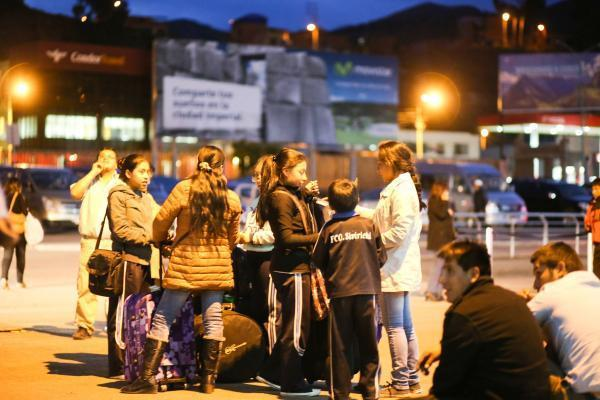 CUZCO, Nov. 25, 2015 (Xinhua) -- People stay on a street after an earthquake in the city of Cuzco, southeast of Peru, on Nov. 24, 2015. An earthquake measuring 7.7 on the Richter scale jolted Peru at