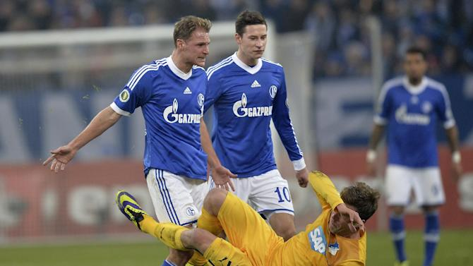 Schalke's Benedikt Hoewedes, left, clashes with Hoffenheim's Sven Schipplock, right, during the German soccer cup third round match between FC Schalke 04 and TSG Hoffenheim in Gelsenkirchen, Germany, Tuesday, Dec. 3, 2013