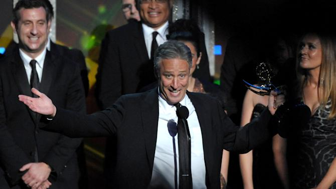"Jon Stewart accepts the award for Outstanding Variety Series for ""The Daily Show with Jon Stewart"" at the 64th Primetime Emmy Awards at the Nokia Theatre on Sunday, Sept. 23, 2012, in Los Angeles. (Photo by John Shearer/Invision/AP)"