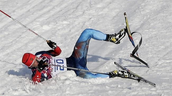 Russia's Anton Gafarov falls with a broken ski during his men's semifinal of the cross-country sprint at the 2014 Winter Olympics, Tuesday, Feb. 11, 2014, in Krasnaya Polyana, Russia. (AP Photo/Matthias Schrader)