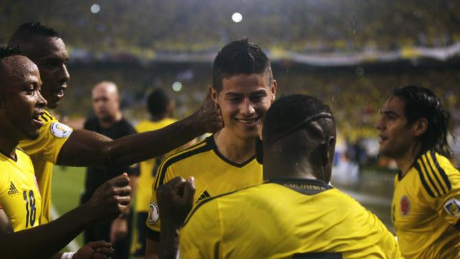 Colombia's Rodriguez celebrates with teammate Armero after scoring against Ecuador in a 2014 World Cup qualifying soccer match in Barranquilla