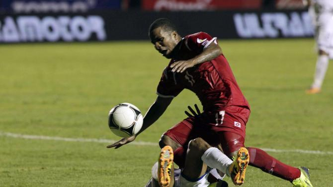 Panama's Henriquez is challenged by Honduras' Garcia during their 2014 World Cup qualifying soccer match in Tegucigalpa